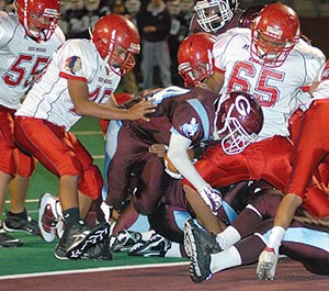 The Red Mesa High Redskin football team in action.