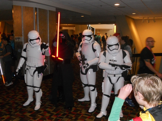 Sith Lord Kylo Ren, who will be in Star Wars: The Force Awakens, with some First Order stormtroopers.